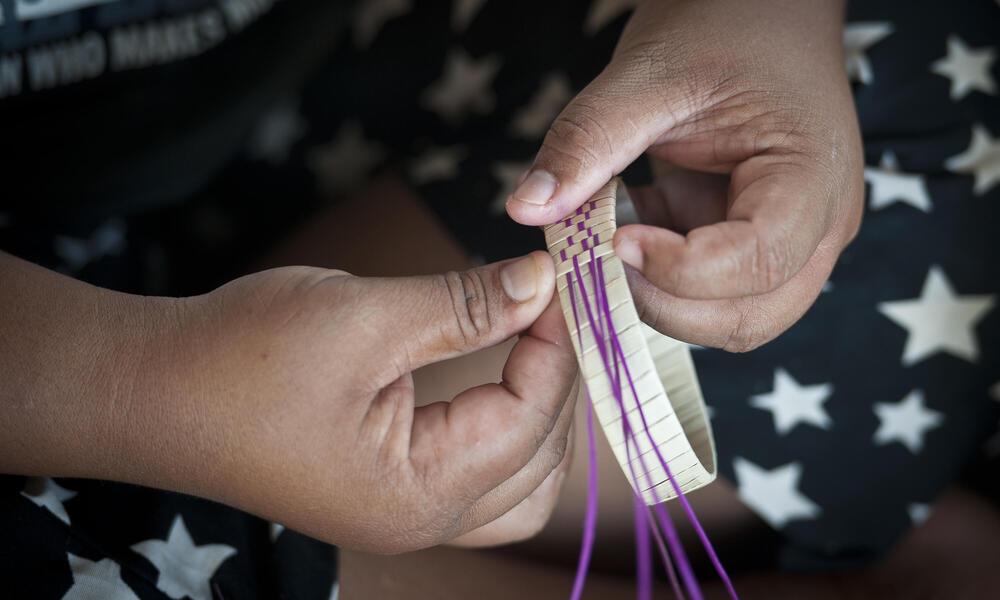 weaving a bracelet