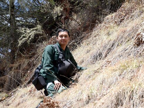 Ugyen Penjor on a hillside