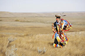 A member of the Lakota First Nations performs a traditional dance at the opening ceremonies celebrating the Black-footed ferret release at Grasslands National Park, Saskatchewan, Canada.