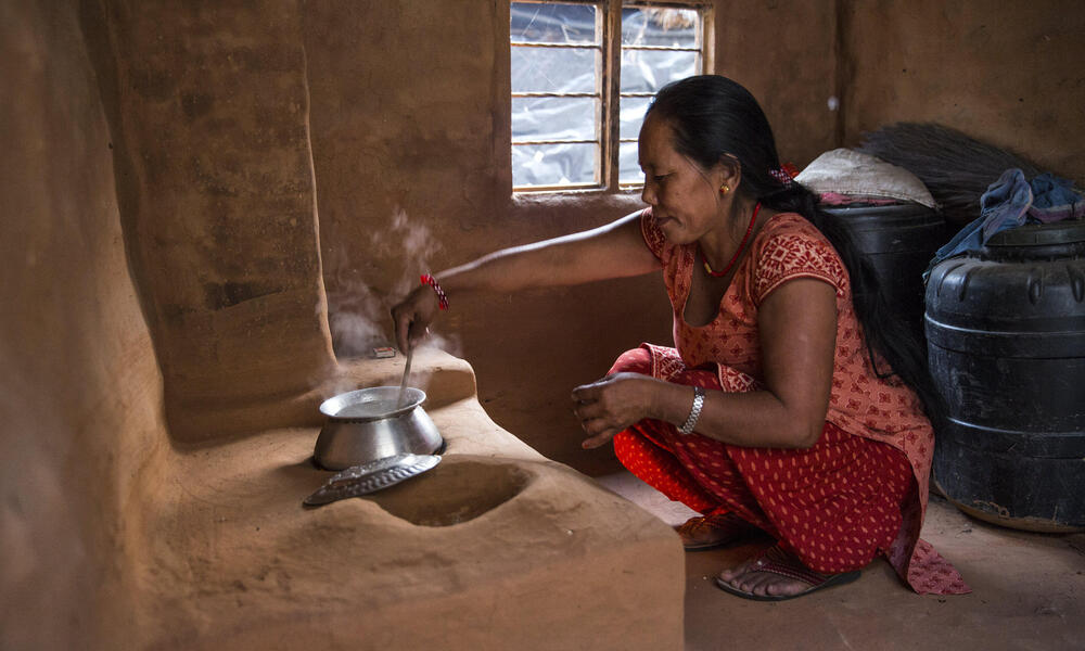 A woman at a cook stove in Nepal
