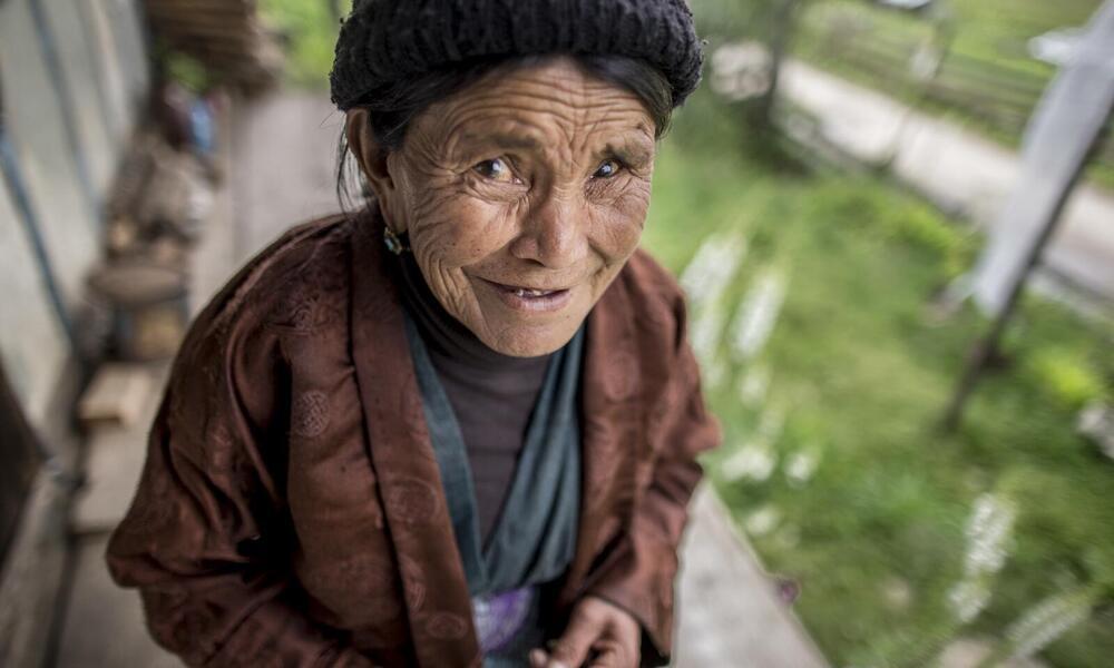 Woman outside her home in Bhutan