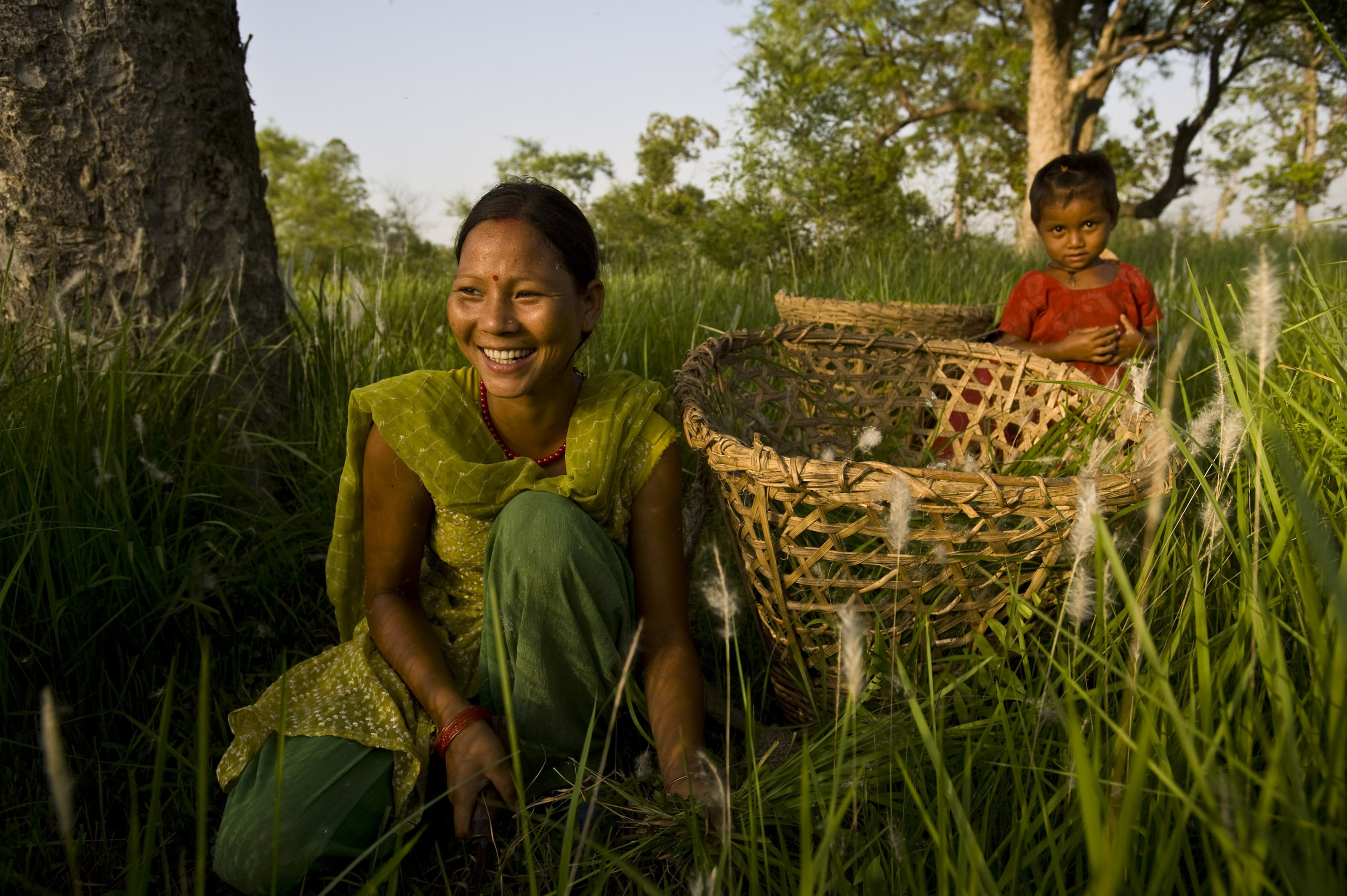 Women in Nepal tending to the grasses