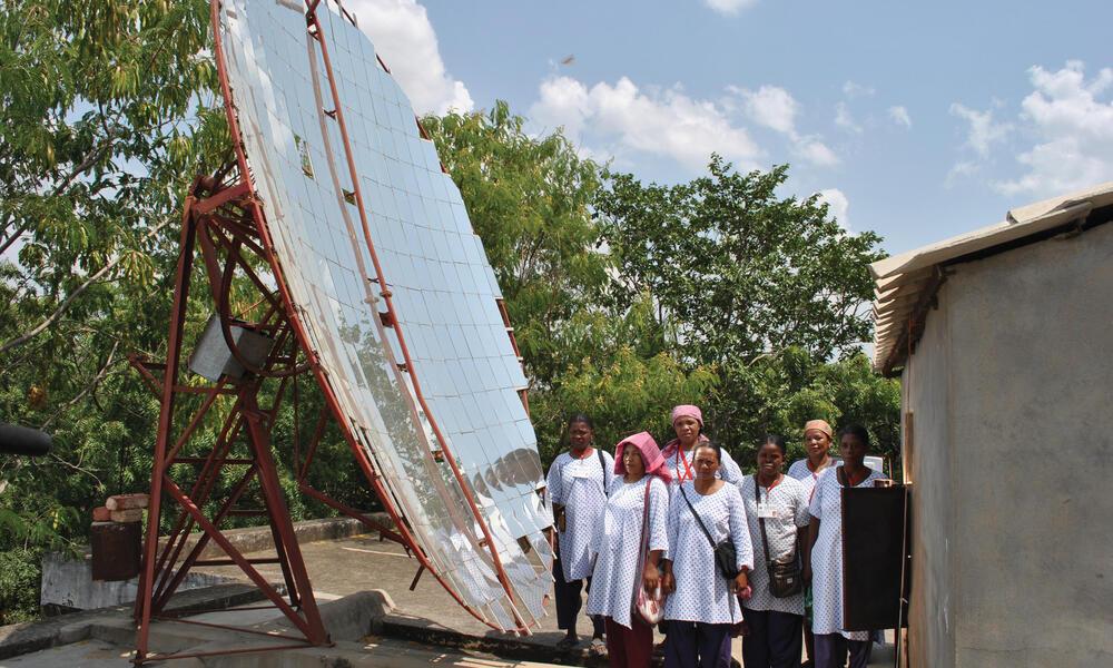 women by solar panel