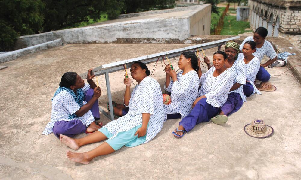 women work on solar