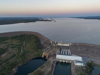 Aerial view of a dam holding back a large river in Brazil