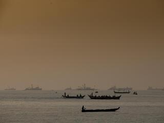 Fishermen on artisanal fishing boats, out at sea, Tema, Ghana.