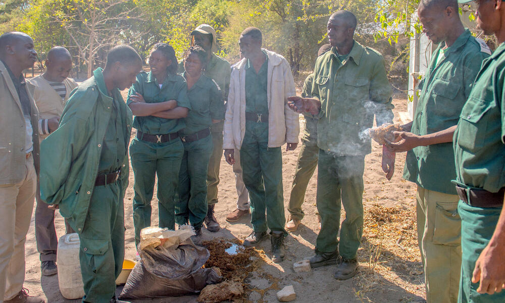 Stephan Mulanda shows a group of guards how to make chili bombs.