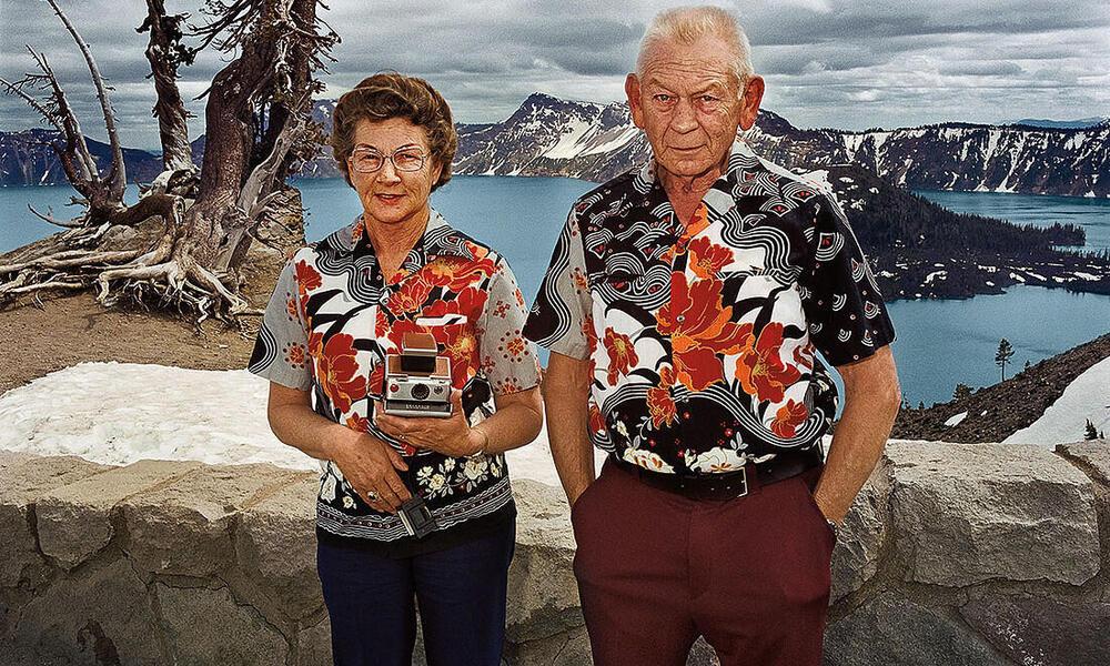 A tourist couple poses for a photo