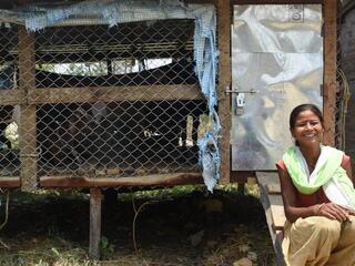 Woman in front of pen of goats in Khata corridor, Nepal
