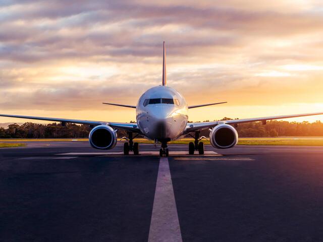 Sunset view of airplane on airport runway under dramatic sky in Hobart,Tasmania, Australia.