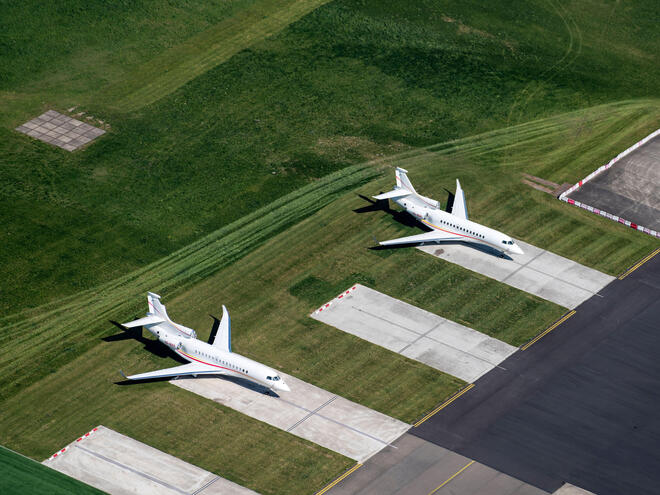 Aerial view of 2 private jets, Dassault Falcon, at The Hague Rotterdam Airport.