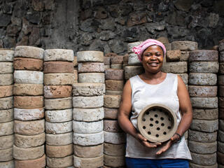 veline Kahindo with clay stove base