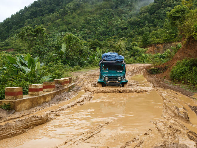 A truck drives through a flooded road in Myanmar.