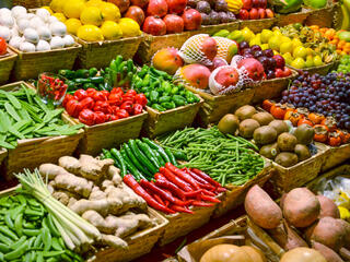 Large display of several rows of fruits and vegetables