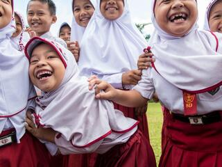 children gathered for mobile education unit in Sumatra
