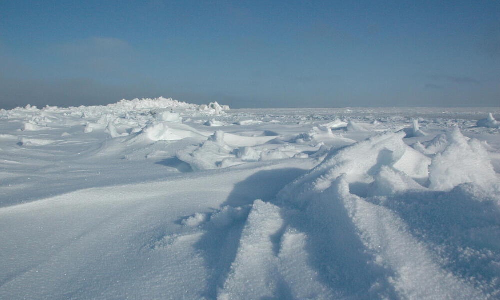 Snow over ice pack and pressure ridges, Vankarem village in Chukotka Province, Russia