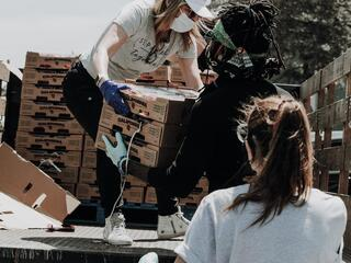 people unloading food from a truck
