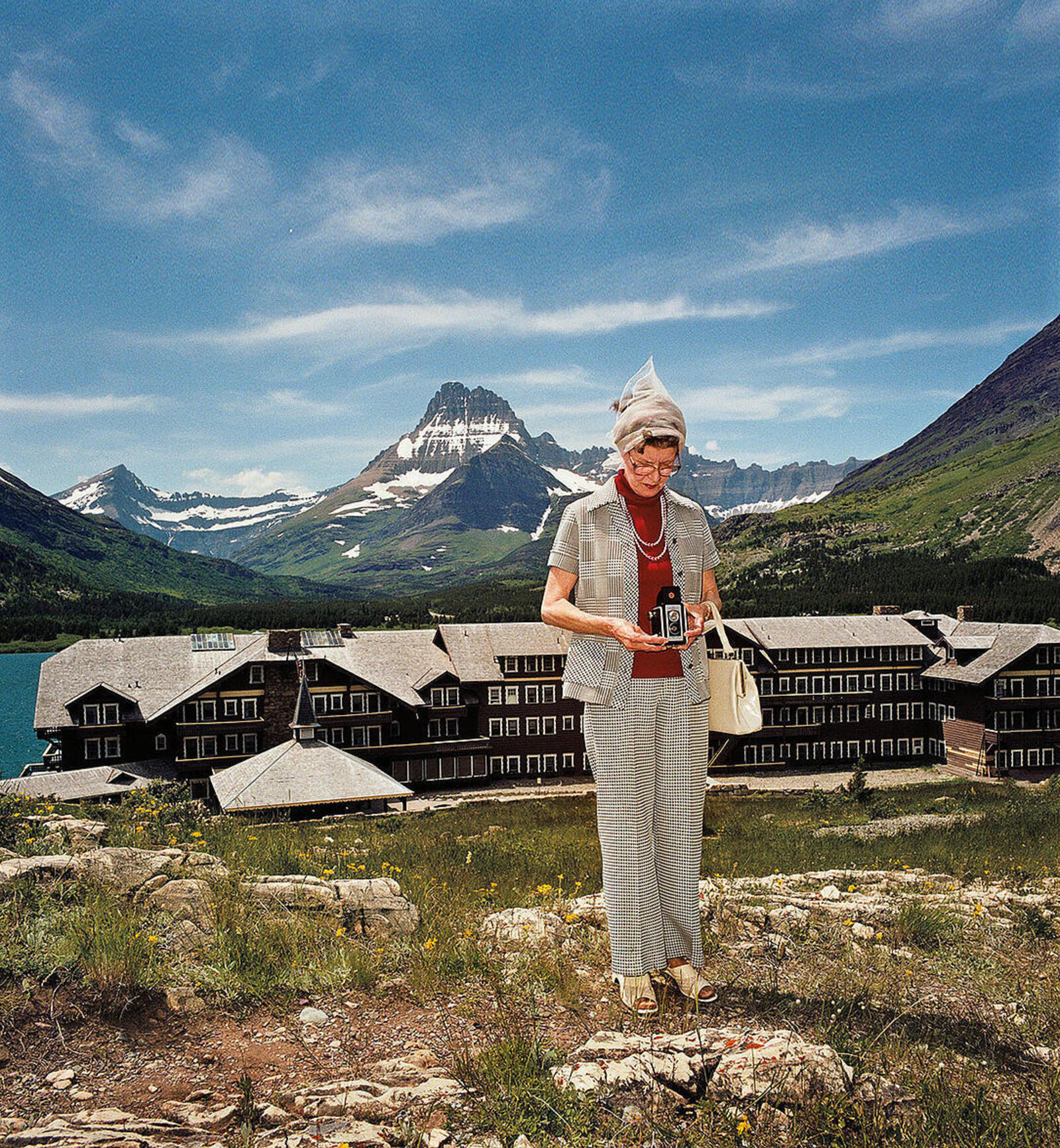 A woman in front of mountains