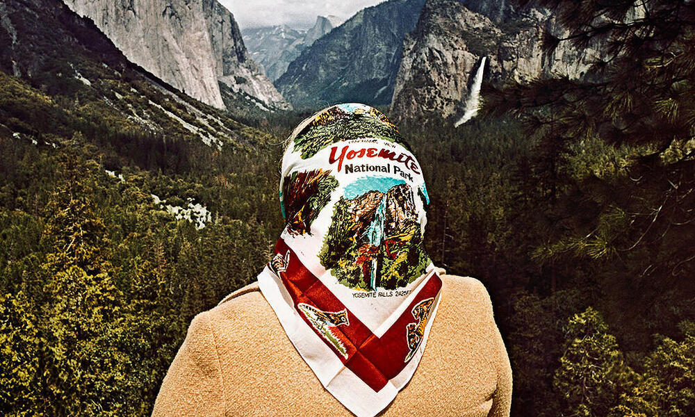 A woman with a Yosemite scarf poses in Yosemite
